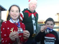 Showing the Santa 5k Fun Run medals at Tralee Bay Wetlands were, Sophie Quillinan, Martin Moore,  and Jamie Quillinan. Photo by Dermot Crean