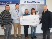 Con O'Connor of Pieta House (right) accepts a cheque from Paul Donovan, Micheál Maher, Ciara Hotchkiss and Anne Lenihan of Borg Warner on Monday. Photo by Dermot Crean