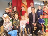 Peter Harty (seated) and Kevin Reardon of CH Tralee with the winners of the Santaland Colouring Competition at the store on Saturday. Photo by Dermot Crean