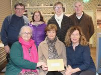 Mary O'Shea (seated centre) of O'Shea's Gala Blennerville hands over a cheque for €350 to Marian Moore and Treasa Walsh of St Vincent de Paul Tralee on Thursday night. Also included are members of Curraheen Choir, Brendan O'Brien, Cathy O'Grady, Phil Leen and Christy Browne. Photo by Dermot Crean