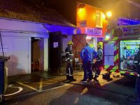 The fire service at the entrance to the beer garden area at Sean Óg's last night after the fire was brought under control.