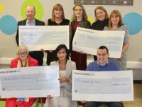 Principal of Kerry College, Mary Lucey (seated centre) with, front left, Chris Griffin of the Irish Cancer Society and Paddy Kevane of St Vincent de Paul. Back from left; Con O'Connor of Pieta House, Mary Galvin of Kerry College, Maria Brosnan of Kerry College and Mary Dolan and Collette Price of Tralee Soup Kitchen, at the presentation of cheques on Tuesday morning. Photo by Dermot Crean