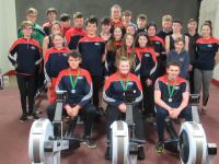Nicolas Larkin, Amy Darcy and Conall MacTheinthir, three of the five medal winners of Tralee Rowing Club at the Irish Indoor Rowing Championships 2020, accompanied by their fellow rowers at the club gym in Tralee.
