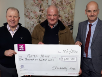 Pat Barry (centre) presents the proceeds of the Stradbally Wren to Con O'Connor and Martin O'Sullivan of Pieta House.