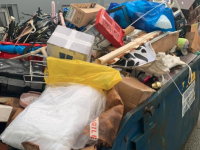 The skip full of useless items which were dropped into the Sera Husky Charity Shop in Tralee.