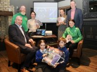 Ciara Griffin (seated right) launching the CBS Primary 'Who Wants To Be A Thousandaire' fundraiser with (also seated) Tom Shanahan of Pallas Marketing. Standing; Adrian O'Mahony of Kingdom Taekwondo, Sarah Barry, Karen Walsh and Principal of CBS Primary Denis Coleman. In front are CBS pupils Zac and Rowan. Photo by Dermot Crean