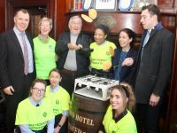 Ger Power and David Moran try their hand at flipping pancakes at the Grand Hotel with Dick Boyle of The Grand, Maura Sullivan of Kerry Hospice, Madelyn Cabrera and Eileen Egan of The Grand Hotel. In front; Natalie Uscinowska, Darlene Lacey and Anne Marie Murphy of The Grand at the charity pancake morning. Photo by Dermot Crean