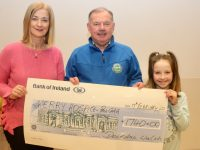 Joe Hennebery of Kerry Hospice Foundation receives a cheque from Radio Kerry's Deirdre Walsh and her daughter Olivia after a fundraiser organised by Deirdre in Listowel in November. Photo by Dermot Crean