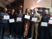 A group of ITT students who received their certificates in mixology.