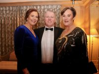 Brenda Litchfield, Kevin Cotter and Fiona Kirby at the Scoil Eoin Valentine's Ball in Ballygarry House Hotel on Friday night. Photo by Dermot Crean