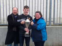 Ruarí O'Sullivan, Tralee CBS & Tralee Parnells, with the Corn Uí Mhuirí along with his proud parents, Mike Roger O'Sullivan, Assistant PRO / Camogie Coach Tralee Parnells and Maria O'Sullivan.