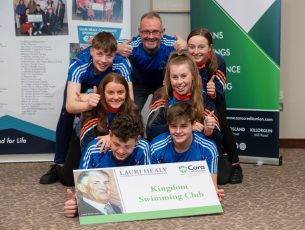 Ger McDonnell and members of Kingdom Swimming Club at Cara Credit Union.
