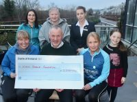 Michelle Greaney (front right) presenting a cheque for €2,200 to Kerry Hospice Foundation representatives Andrea O'Donoghue and Dan Galvin. Also included is Claire O'Connor, Ita Greaney, Orla Greaney and Megan Barrero. Photo by Dermot Crean
