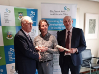 Benoit Lorge of Lorge Chocolates receives his award from Charlie O'Sullivan of Kerry County Council and Tomás Hayes of Kerry Local Enterprise Office.