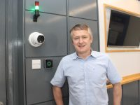 Oliver Molloy of Quirke Security Ltd. with one of the temperature screening devices installed at a local company.