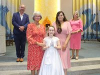 Erin Curley, with Patricia Murray and Niamh Curley at her First Holy Communion at Our Lady and St Brendan's Church on Saturday. Also included is Principal of Holy Family Ed O'Brien and teacher Alice Carmody. Photo by Dermot Crean