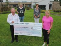 Michelle Greaney presents €11,300 to Joe Hennebery of Kerry Hospice Foundation. Also included is Andrea O'Donoghue and Mary Shanahan. Photo by Dermot Crean