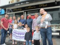 William McCarthy, Aria and Patrick McCarthy Jnr, Millie and Johnny McCarthy, Tommy McCarthy, Patrick McCarthy and Paul O'Sullivan with his two children. In front is Holly, Evie, Louis and Ella Mai McCarthy.