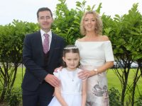 Scoil Eoin pupil Bronagh Griffin, with Kieran and Aileen Griffin, after making her First Holy Communion at Our Lady and St Brendan's Church on Saturday. Photo by Dermot Crean