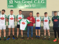 Terry Healy of Terry's Butchers Oakpark presenting a set of new jerseys to Na Gaeil senior team in Killeen last week.