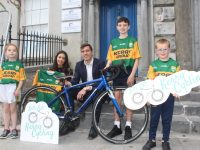 Winners in the 'Let's Get Kerry Cycling'  Campaign competition being presented with their signed Kerry jerseys on Tuesday. From left; Niamh O'Brien,  Sandra Caffrey (accepting for her nephew Lee), Kerry footballer David Moran, Aaron Horgan and Oran O'Sullivan. Missing from photo is the other winner Rian O'Sullivan. Photo by Dermot Crean