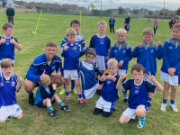 Barry John Keane pictured here with his son Leo and his team of U8 Boys who hosted Currow in Ballyrickard last Sunday.