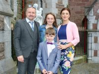 Moyderwell pupil Christian O'Shea, with David, Abigail and Teresa O'Shea, at his First Holy Communion at St John's Church on Saturday. Photo by Dermot Crean