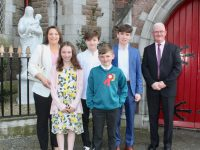 Former Moyderwell Primary School pupil Luke O'Sullivan, with  Melanie, Kelly, Ben, Michael and Martin O'Sullivan, on his Confirmation Day at St John's Church on Sunday. Photo by Dermot Crean