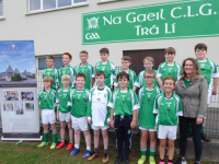 Bríd Ni Mhathúna presents a new set of jerseys to the Na Gaeil U12 team on behalf of the Meadowlands Hotel.