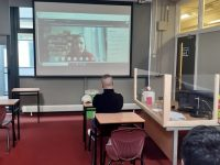 Niamh Doyle from Kerry County Library Services on screen in a socially distanced classroom at Kerry College's Clash Road Campus.