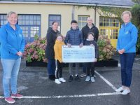 Maura Sullivan and Andrea O'Donoghue of Kerry Hospice Foundation with the Silles family Paula, Amy, Luke, Oran and Tony who handed over a cheque for €3,720 on Tuesday. Photo by Dermot Crean