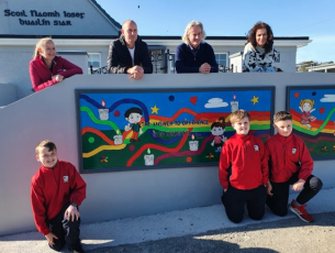 Jennifer Boyle & John Keane (Parent Council members) with Terence Dineen (Principal) and Lisa Harkin look on as Luke Boyle. George &Sam Keane admire Lisa's painting with John Hume's words 'The answer to difference is to respect it'.