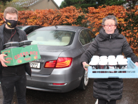 Luke Bishop and Aileen Assa of GAllys loading up coffees and cakes to deliver to the Palliative Care Unit at University Hospital Kerry. Photo by Dermot Crean