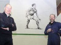 John O'Keeffe  with artist Mike O'Donnell at the painting of the Kerry great in CBS The Green sports hall. Photo by Dermot Crean