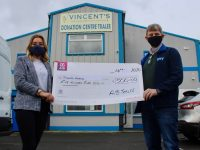 Caroline McCarthy of timberkitbuildings.ie presents a cheque to Junior Locke of St Vincent de Paul at their depot in Monavalley. Photo by Dermot Crean