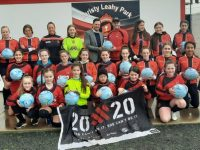 Philip Dewey of Thorn presenting footballs to the St Brendan's Park FC Girls Squad.