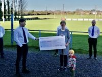 Maura Sullivan of Kerry Hospice received a cheque for €2,900 from Tralee RFC members on Wednesday.