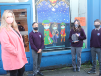 Art teacher Mary J Leen with Coláiste Gleann Lí pupils at their decorated shopfront at Castle Street (old Utensils shop). Photo by Dermot Crean