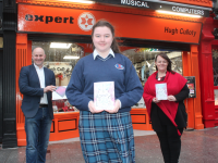Marissa Hanley, a Transition Year Student at Causeway Comprehensive School, who won the top prize in the Kerry ETB Christmas Card Competition with Brendan Culloty of Hugh Culloty Expert (sponsors) and teacher Caroline Fitzgibbon. Photo by Dermot Crean