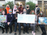 Presentation Secondary School students presenting the amount raised for the SVP Tralee Toy Appeal. In front; Sarah Carty, Kiah Robinson, Ciara Laide, Vanessa Popko, Treasa Walsh of SVP Tralee and Maria Synowiecka. Back from left; Principal Chrissie Kelly, Marian Moore of SVP Tralee, Sharon Sheehan of Toys Upstairs, Anne O'Sullivan of Toys Upstairs and Margaret Barry, CSPE teacher. Photo by Dermot Crean