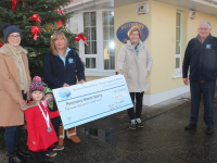 Aoife O'Donoghue with her children Neasa and Ronán, present a cheque for €855 to Kathleen Collins, Maureen O'Brien and Dermot Crowley of Recovery Haven. Photo by Dermot Crean