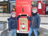 Hugh and Óisín O'Donnell posting their Santa letters in the Tralee Rotary Club's Santa Letterbox on Saturday in The Square. Photo by Dermot Crean