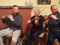 Paul Sexton, Ciarán Kelleher and Tom O'Connor belting out the tunes at Faha rambling House, 2019