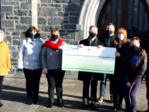 The presentation of funds to Ardfert/Kilmoyley Parish for the purchase of webcams.
