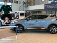 Jordan Lee jumping off joy as he collects his brand new 211 Toyota C-HR from the team at Kellihers Garage in Tralee.