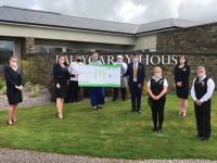 Ballygarry House Hotel staff present the cheque to Louisa New of Barnardos.