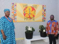 Goodluck Uzama and Samuel Kiwanuka at the new mural at the Tralee International Resource Centre. Photo by Dermot Crean