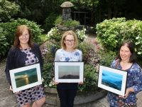 Prizewinners in the Phoenix Women's Centre's photo competition received their prizes at the Meadowlands Hotel on Wednesday. Picture are, from left; Ann Sheehan (2nd), Anne Kelly (1st) and Noreen O'Shea (3rd) holding their winning entries. Photo by Dermot Crean