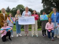 Caroline Flahive of Kerry Adolescent Counselling Services (centre) accepts a cheque from pupils of Presentation Primary School. Also included is teacher Helena Hennessy and teacher/counsellor Celene O'Callaghan. Photo by Dermot Crean