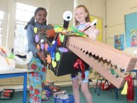Presentation Primary School Fourth Class students Hala Wael and Ellie O'Brien with the dragon they made during their Artists in Schools project in conjunction with the Arts Council. Photo by Dermot Crean